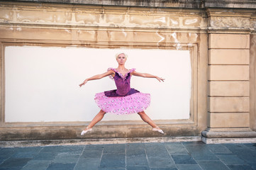 Young beautiful ballerina jumping in Bologna - Pincio, Italy. Ba