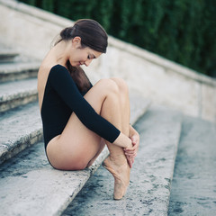 Young beautiful ballerina posing on the Spanish Steps in Rome.
