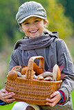Season for mushrooms -  girl with basket of picked mushrooms