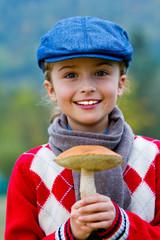 Season for mushrooms -  girl with picked fresh edible mushroom