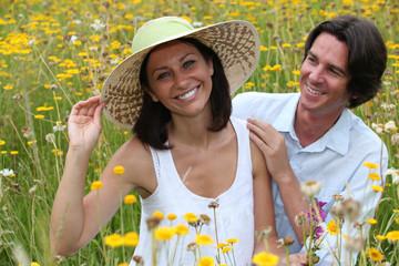Couple in field of flowers