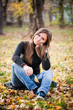 beautiful thoughtful girl  in autumn park