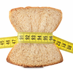 Piece of bread grasped by measuring tape