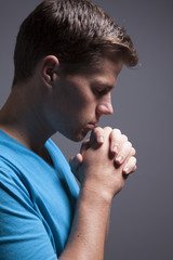Man Praying With Folded Hands