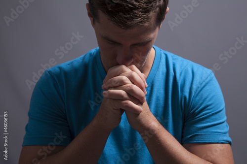 Young Man Prays