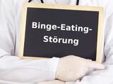 Doctor shows information: binge eating disorder poster