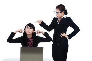 Business woman yelling at employee