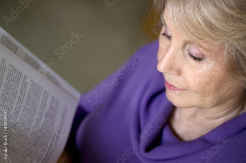 Mature older woman reading a book