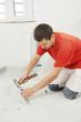 Parquet Floor worker with hammer