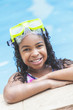 African American Girl Child In Swimming Pool with Goggles