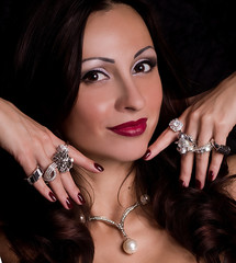 Portrait of beautiful young woman with jewelry