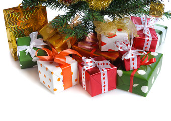 red gift boxes under Christmas tree