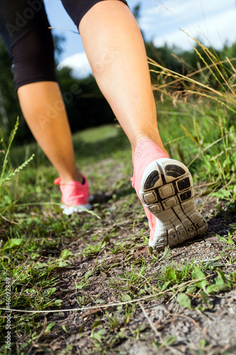 Walking or running legs in forest, summer nature activity