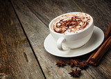 Fototapety coffee cup and beans, cinnamon sticks, nuts and chocolate on woo
