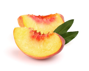 Slices of peach with leaves
