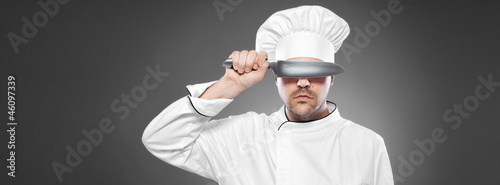 Chef  posing against gray background