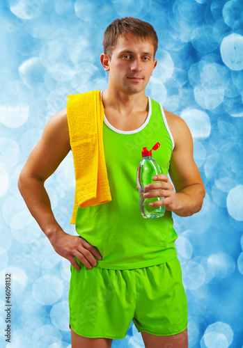 sportsman with bottle of water