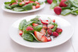 Fresh strawberries and baby spinach salad