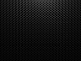 Black metal background with hexagon holes