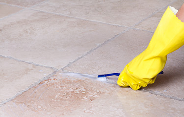 Cleaning tile grout with toothbrush