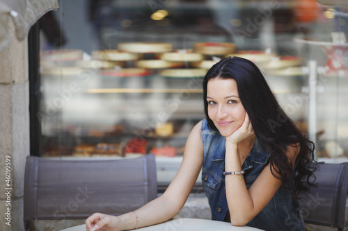 woman in street cafe