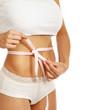 A slim girl measuring her waist, closeup