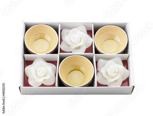 Tea cups and white flower candle storage in the box as a special