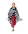 Junge Frau in festlicher Tracht mit Mantel