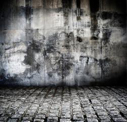 Fond rue en pavé et mur abimé