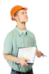 A builder is looking up with a folder and a pen on white