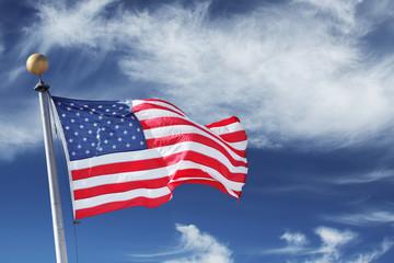Windblown USA Flag on blue sky background