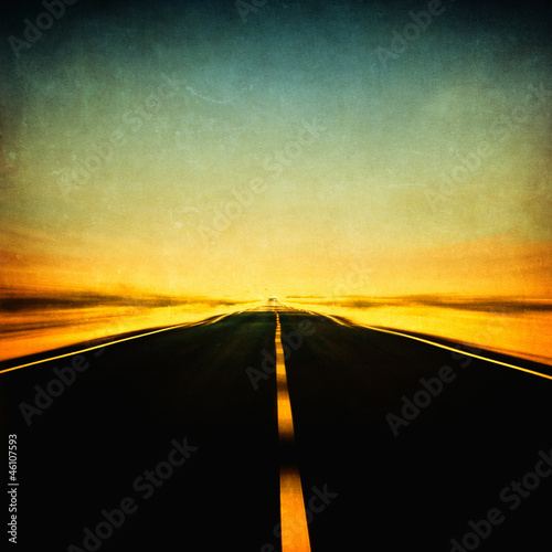 grunge image of highway and blue sky in motion blur