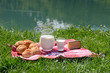 Milk, cheese and bread in an Alpine meadow, Switzerland
