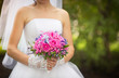Bride with pink and purple wedding bouquet