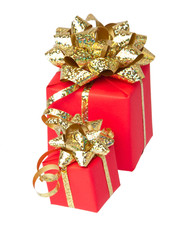 Two gifts wrapped with golden bow, white background