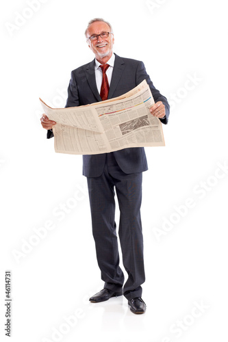 Standing senior business man with newspaper