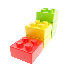 Three step stair made of toy construction brick blocks