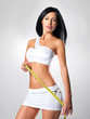 Sporty beautiful woman with measure tape