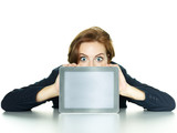 Business woman watching surprised over her tablet pc