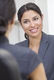 Hispanic Latina Woman or Businesswoman in Office Meeting