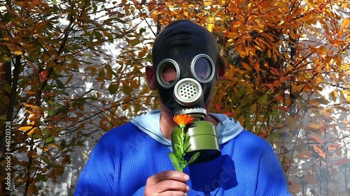 Man in gas mask in fog