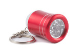 Red metal LED flashlight keychain isolated on white background