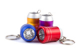 Set of four metal LED flashlight keychain isolated on white back