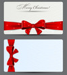Gift cards with red bow.