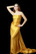 woman in long golden dress