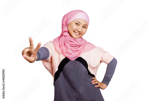 Beautiful young muslim woman isolated on white background