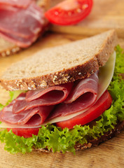 fresh deli sandwich with tomatoes, swiss chees