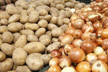 Potatoes and onions in a grocery