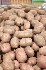 Big red potatoes in a grocery