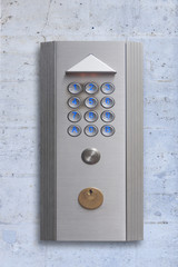 Intercom doorbell panel on stone doorway, isolated